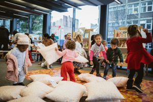Children playing with pillows and dancing
