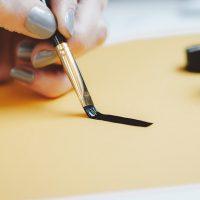 An artist using a calligraphy brush