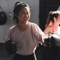 Two women boxing in a gym
