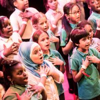 Children performing with Newham Music