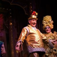 A panto performance with gleaming gold costumes